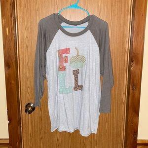 Woman's plus size 3/4 sleeve Fall shirt